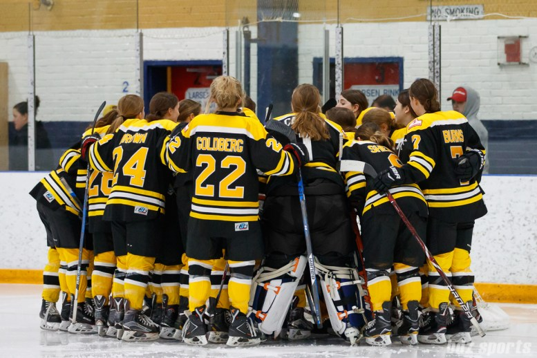 The Boston Blades huddle before the start of their last 2017-2018 season game