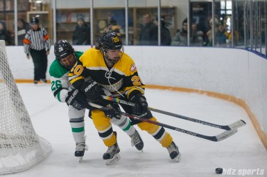 Markham Thunder forward Jamie Lee Rattray (26) and Boston Blades defender Meaghan Spurling (20)