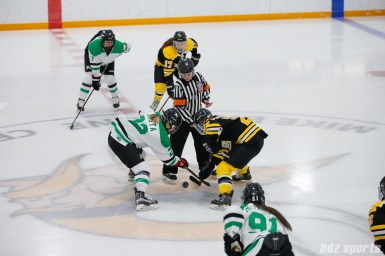 Markham Thunder forward Nicole Kosta (22) and Boston Blades forward Melissa Bizzari (23) take the opening face-off