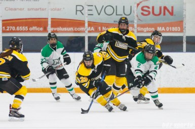 Boston Blades forward Kate Leary (28) works to keep the puck away from Markham Thunder forward Becca King (2)
