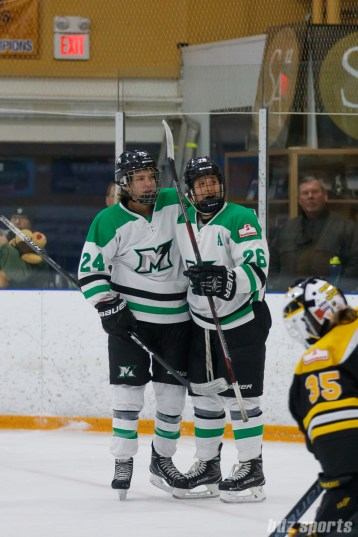 Markham Thunder players Kristen Barbara (24) and Jamie Lee Rattray (26) celebrate Rattray's goals