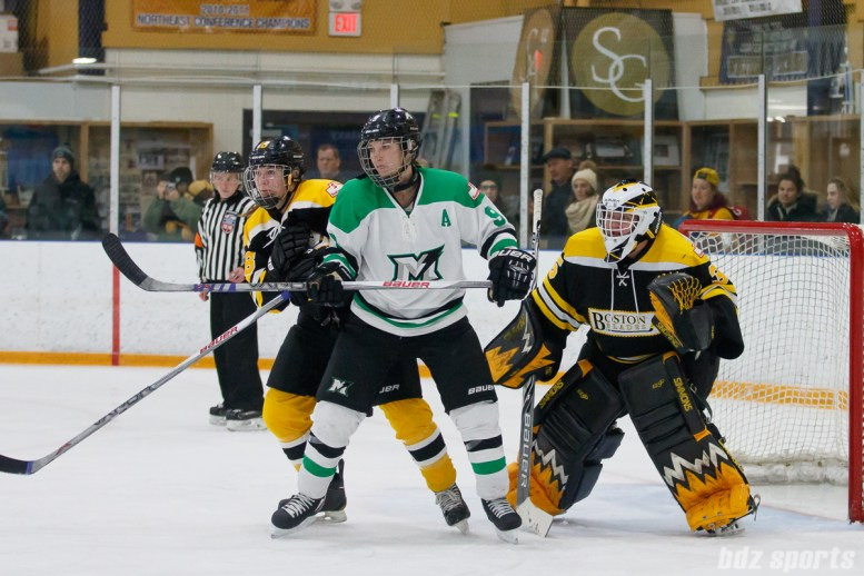 Boston Blades players Taryn Harris (18) and Lauren Dahm (35) defend against Markham Thunder forward Kristen Richards (9)