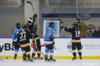 Boston Pride forward Jillian Dempsey (14) celebrates her goal with teammates Heather Schwarz (37) and Mary Parker (7)