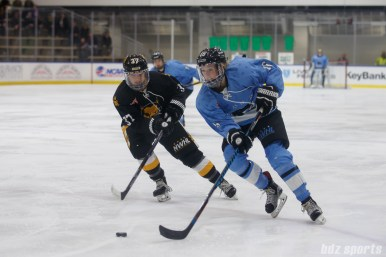 Buffalo Beauts forward Maddie Elia (16) and Boston Pride forward Heather Schwarz (37)