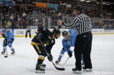 Boston Pride forward Jillian Dempsey (14) and Buffalo Beauts forward Kristin Lewicki (27)