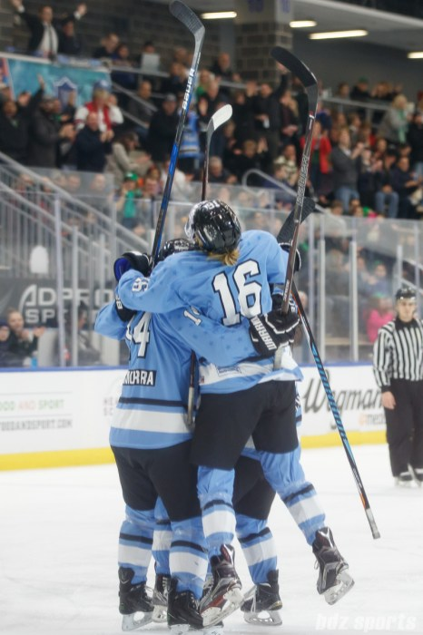 The Buffalo Beauts celebrate defender Sarah Edney's (3) goal