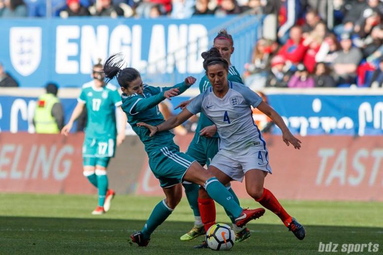 Team England midfielder Fara Williams (4) battles Team Germany forward Hasret Kayikci (23) for the ball