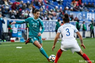 Team Germany forward Hasret Kayikci (23) takes on Team England defender Demi Stokes (3)