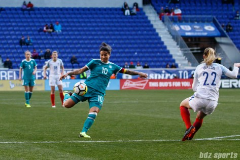 Team Germany midfielder Dzsenifer Marozsan (10) volleys the ball out of the air