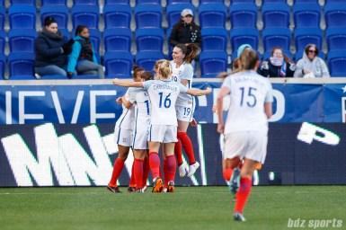 Team England celebrates Ellen White's (18) equalizer