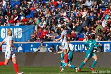 Team England defender Abby McManus (15) heads the ball