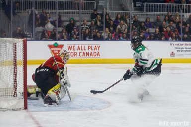 Markham Thunder forward Laura Stacey (7) and Kunlun Red Star goalie Noora Raty (41)