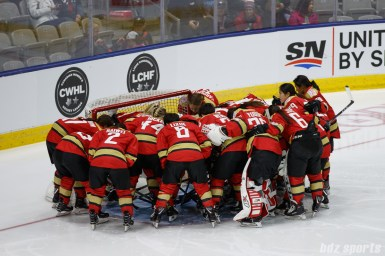 The Kunlun Red Star huddle before the start of the Clarkson Cup Final