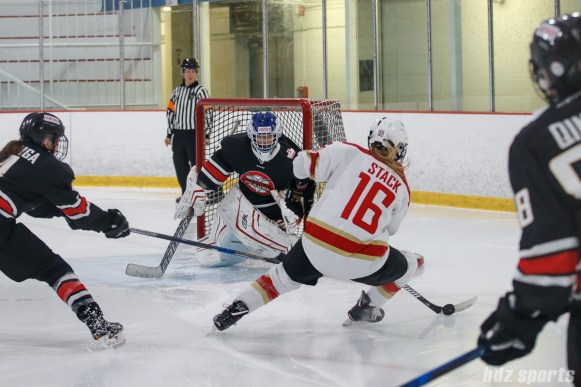 Kunlun Red Star forward Kelli Stack (16) and Vanke Rays goalie Tianyi Zhang (39)