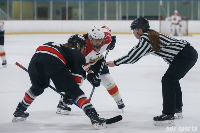 Kunlun Red Star forward Liying Yang (18) and Vanke Rays forward Emily Janiga (4) take a face-off