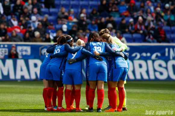 France women's national soccer team huddle before the start of their SheBelieves Cup game against U.S. women's national soccer team on March 4, 2018