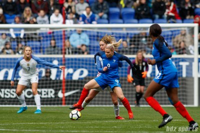 Team France forward Eugenie Le Sommer (9) shields the ball from Team USA midfielder Morgan Brian (6)