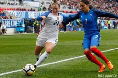 Team USA forward Savannah McCaskill (21) looks to play the ball agianst Team France defender Amel Majri (7)