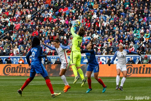Team France goalie Sarah Bouhaddi (16) collects the ball out of the air