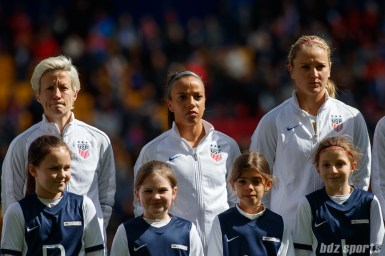 Team USA midfielder Megan Rapinoe (15), forward Mallory Pugh (11), and midfielder Lindsey Horan (9)