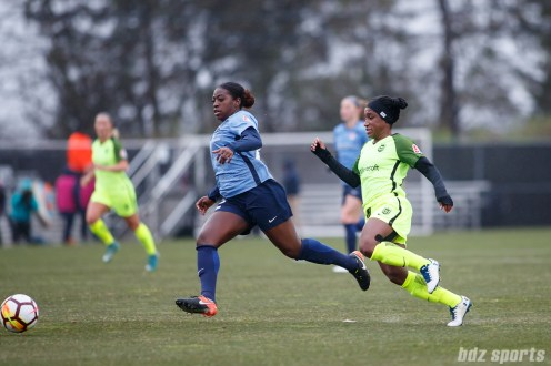 Sky Blue FC defender Mandy Freeman (22) and Seattle Reign FC forward Jasmyne Spencer (22)