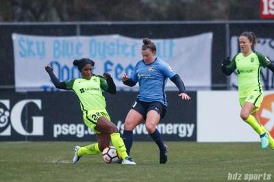 Seattle Reign FC forward Jasmyne Spencer (22) and Sky Blue FC forward Savannah McCaskill (21)