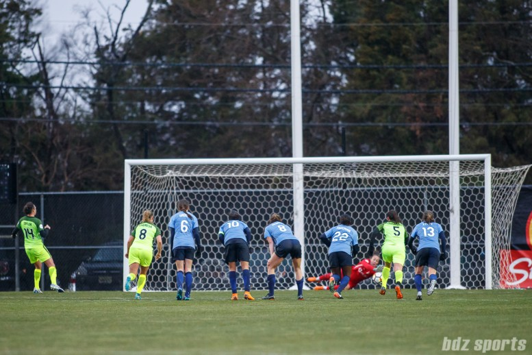 Sky Blue FC goalie Kailen Sheridan (1) comes up with the penalty kick save