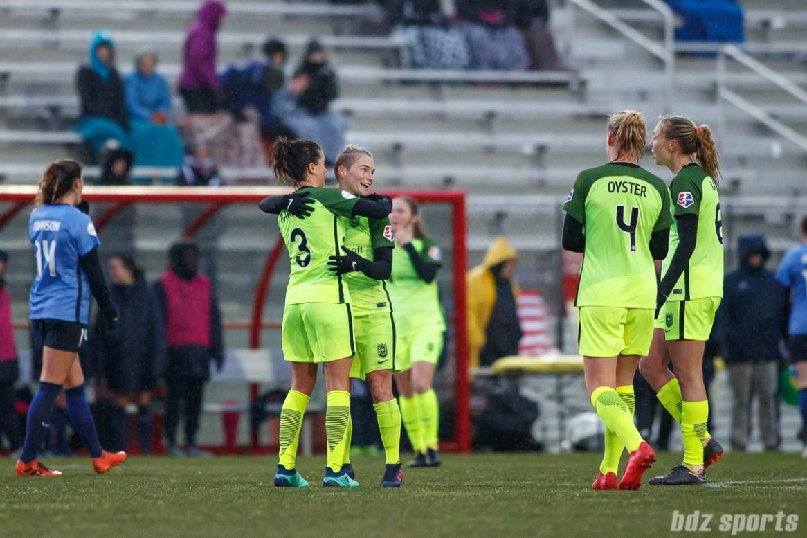 Seattle Reign FC defender Lauren Barnes (3) and midfielder Jessica Fishlock (10) celebrate their 1-0 win over Sky Blue FC