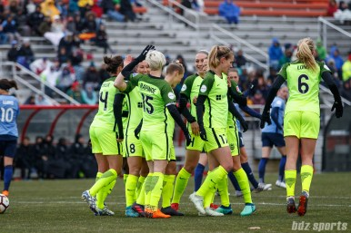 Seattle Reign FC forward Megan Rapinoe (15) celebrates her penalty kick goal with Seattle Reign FC defender Theresa Nielsen (8)