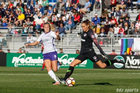 Washington Spirit goalkeeper Aubrey Bledsoe (1) clears the ball while being challenged by Orlando Pride forward Rachel Hill (15)