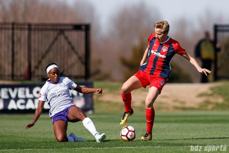 Orlando Pride forward Chioma Ubogagu (6) and Washington Spirit midfielder Rebecca Quinn (4)