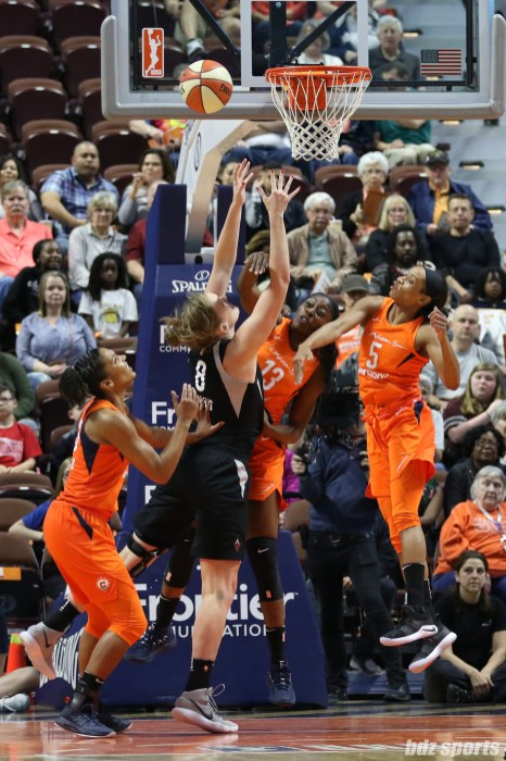Las Vegas Aces center Carolyn Swords (8) and Connecticut Sun forward Chiney Ogwumike (13)