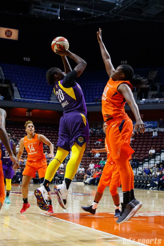 Los Angeles Sparks forward Shakayla Thomas (20) and Connecticut Sun forward Shekinna Stricklen (40)
