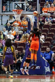 Connecticut Sun forward Chiney Ogwumike (13) and Los Angeles Sparks guard Karlie Samuelson (44)