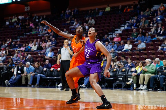 Connecticut Sun forward Nikki Greene (54) and Los Angeles Sparks center Taya Reimer (22)