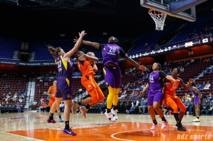 Connecticut Sun forward Betnijah Laney (44) goes up against Los Angeles Sparks players Kathryn Westbeld (33) and Shakayla Thomas (20)