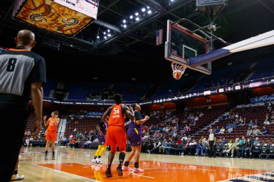 Connecticut Sun guard Rachel Banham's shot falls through the basket as time expires