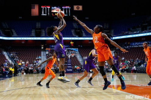 Los Angeles Sparks guard Cappie Pondexter (25) and Connecticut Sun forward Chiney Ogwumike (13)