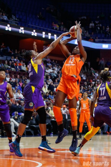 Connecticut Sun forward Chiney Ogwumike (13) and Los Angeles Sparks forward Nneka Ogwumike (30)