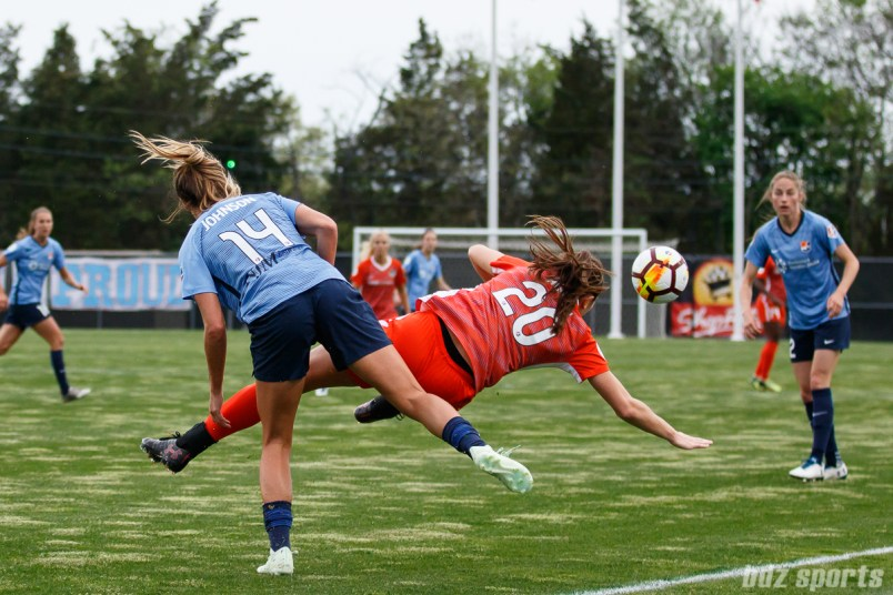 Sky Blue FC forward Katie Johnson (14) and Houston Dash defender Lindsay Agnew (20)