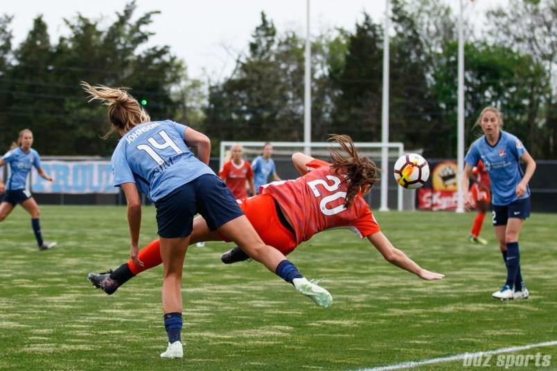 Sky Blue FC forward Katie Johnson (14) and Houston Dash defender Lindsay Agnew (20)