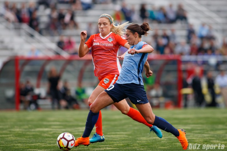 Houston Dash midfielder Kristie Mewis (19) and Sky Blue FC midfielder Carli Lloyd (10)