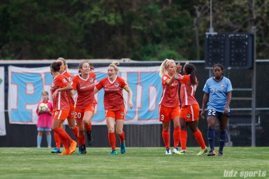 The Houston Dash celebrate their first goal of the game