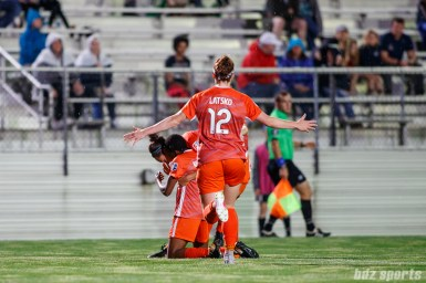 Houston Dash forward Veronica Latsko (12) celebrates her goal with teammate Thembi Kgatlana (11) who provided the assist