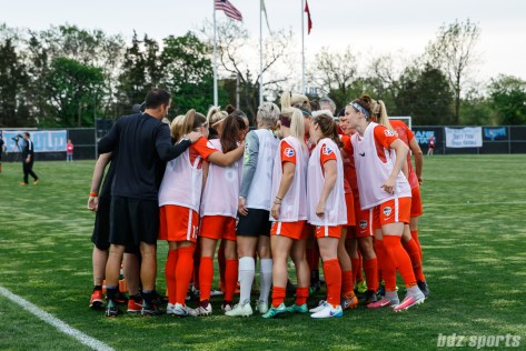 The Houston Dash huddle before the start of the game
