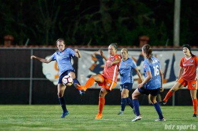 Sky Blue FC forward Shea Groom (6) and Houston Dash midfielder Kyah Simon (17)