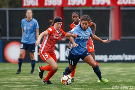 Houston Dash midfielder Haley Hanson (9) and Sky Blue FC midfielder Raquel Rodriguez (11)