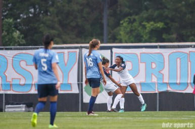 North Carolina Courage forward Crystal Dunn (19) celebrates her goal with teammate midfielder Debinha (10)
