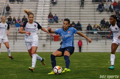 Sky Blue FC midfielder Thaisa Moreno (5) and North Carolina Courage midfielder McCall Zerboni (7)