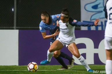 Sky Blue FC midfielder Sarah Killion (16) and North Carolina Courage forward Darian Jenkins (21)